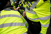 Police arrest and remove protesters as they try to clear climate change activists from the Extinction Rebellion group at Oxford Street near to the Marble Arch camp in protest that the government is not doing enough to avoid catastrophic climate change and to demand the government take radical action to save the planet, on 24th April 2019 in London, England, United Kingdom. Extinction Rebellion is a climate change group started in 2018 and has gained a huge following of people committed to peaceful protests.
