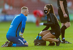 WREXHAM, WALES - Thursday, September 17, 2020: Physio Gemma Bamford treats Connah's Quay Nomads' goalkeeper Lewis Brass for an injury during the UEFA Europa League Second Qualifying Round match between Connah's Quay Nomads FC and FC Dinamo Tbilisi at the Racecourse Ground. Dinamo Tiblisi won 1-0. (Pic by David Rawcliffe/Propaganda)