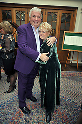 CHRISTOPHER BIGGINS and GLORIA HUNNIFORD at 'Lunch for Life' in aid of Marie Curie Cancer Care held at Wentworth Golf Club, Berkshire on 2nd march 2009.