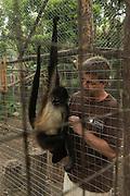 Paul Walker of Wildtracks and Geoffroy's spider monkey (Ateles geoffroyi)<br /> Primate Rehabilitation Center<br /> Sarteneja<br /> Belize,<br /> Central America