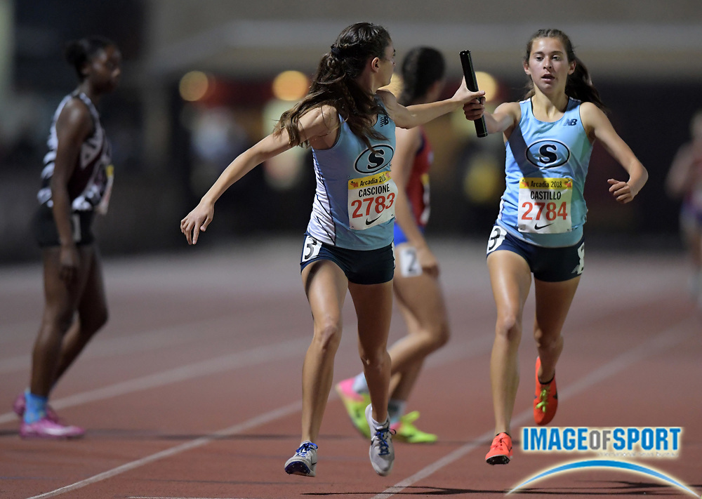 Jacqueline Cascione takes the handoff from Mariah Castillo on the second leg of the Saugus girls 4 x 1,600m relay that placed fifth in 21:05.51 during the 51st Arcadia Invitational in Arcadia, Calif., Friday, April 6, 2018.