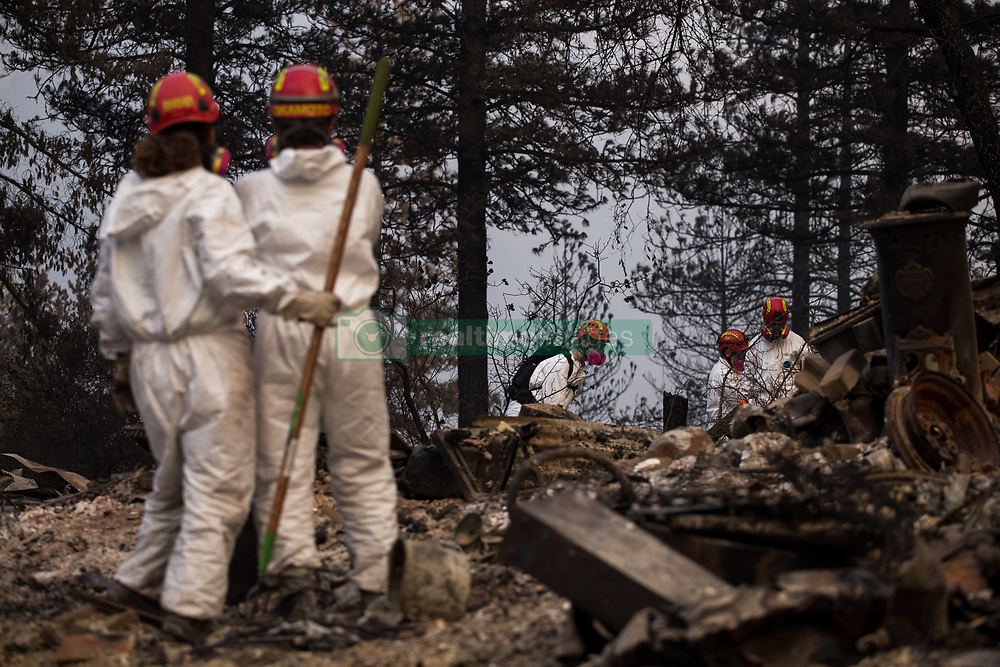 November 17, 2018 - California, USA - Santa Clara County Sheriff's search and rescue teams continue a search for missing Camp Fire victims in Magalia, California. At least 71 people have been confirmed dead and over 1,000 others remain missing due to the Camp Fire as of Nov. 17 according to the Butte County Sheriff's Department. (Credit Image: © Joel Angel Juarez/ZUMA Wire)