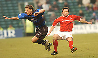 GILLINGHAM VS NOTTINGHAM FOREST<br />6TH MARCH 2004<br />GILLINGHAM'S NICKY SOUTHALL AND FOREST ANDY REID FLY THROUGH THE AIR WITH THE GREAST OF EASE.<br /><br />Picture Ady Kerry