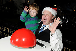 © under license to London News Pictures.  19.11.2010, Mr Tumble (Justin Flecter,MBE) from CBBC.switching the xmas lights on at the winter gardens,Bluewater,Greenhithe,.Kent.hitting the button,  sam meads age 2 from kent helping switch the lights on..Picture credit should read Grant Falvey/London News Pictures