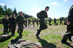 Warming up before the 2 mile march..Exercise Guards Warrior with the Scots Guards at their Catterick base..Pic ©2010 Michael Schofield. All Rights Reserved.