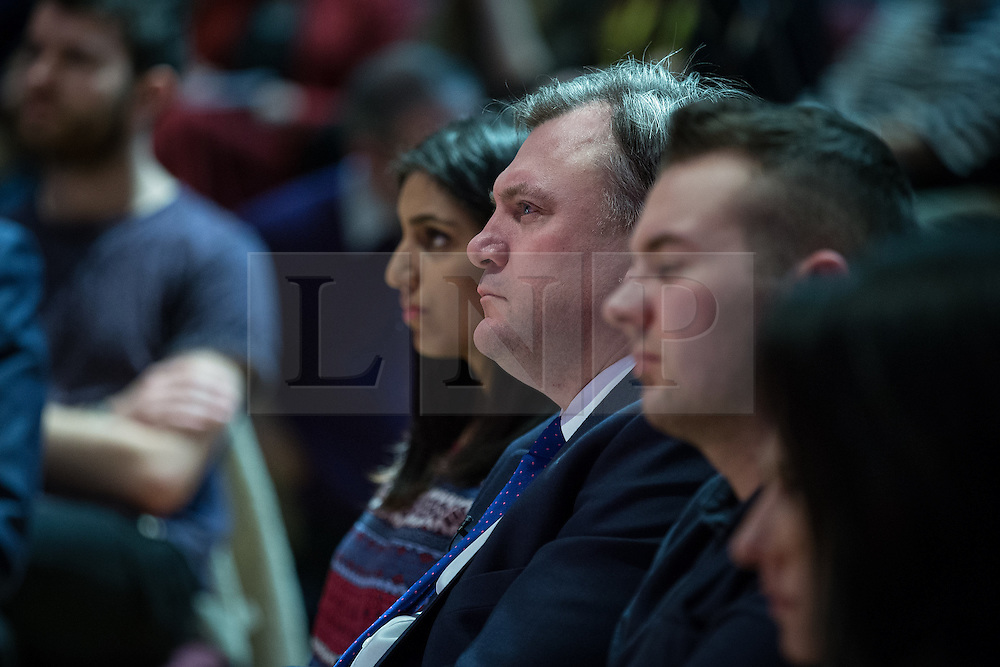© Licensed to London News Pictures . 27/02/2015 . Leeds , UK . ED BALLS in the audience as Ed Miliband speaks at the launch of the Labour Party's fourth election pledge at a speech on young people . British Labour Party leader Ed Miliband and Shadow Chancellor Ed Balls at Leeds College of Music today ( Friday 27th February 2015 ) . Photo credit : Joel Goodman/LNP