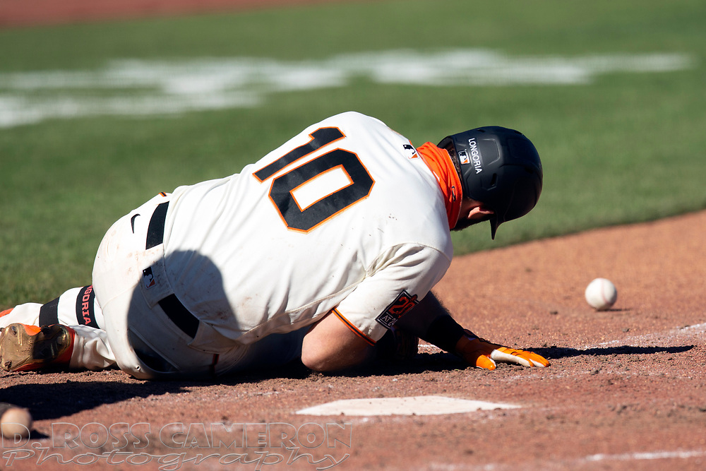 San Francisco Giants' Evan Longoria (10) lays on the dirt after being hit by a pitch by Seattle Mariners pitcher Yohan Ramirez during the eighth inning of a Major League Baseball game, Thursday, Sept. 17, 2020 in San Francisco. The Giants defeated the Mariners 6-4. This is a makeup of a postponed game from Wednesday in Seattle. (AP Photo/D. Ross Cameron)