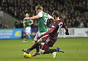 12 Hearts of Midlothian Midfielder Tasos Avlonitis making the vital tackle during the Scottish Cup fifth round replay match between Hibernian and Heart of Midlothian at Easter Road, Edinburgh, Scotland on 22 February 2017. Photo by Craig McAllister.