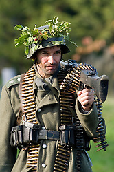 German Machine Gunner from the Grossdeutschland Division carrying an MG42 machine gun and ammunition belts, <br />