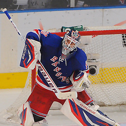 May 12, 2012: New York Rangers goalie Henrik Lundqvist (30) makes a high shrugging save during third period action in game 7 of the NHL Eastern Conference Semi-finals between the Washington Capitals and New York Rangers at Madison Square Garden in New York, N.Y. The Rangers defeated the Capitals 2-1.