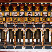 Asia, Bhutan, Thimpu. Prayer wheels in a local public square in central Thimpu, Bhutan.