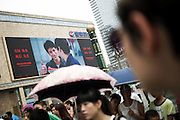 "Chinese people wait to cross the street in the city centre of Chengdu, China, August 10, 2014.<br />   <br /> This picture is part of the series ""Urban Chinese Streets"", a journey on the streets of Chinese cities to discover their modern citizens and habits.        <br /> <br /> © Giorgio Perottino"