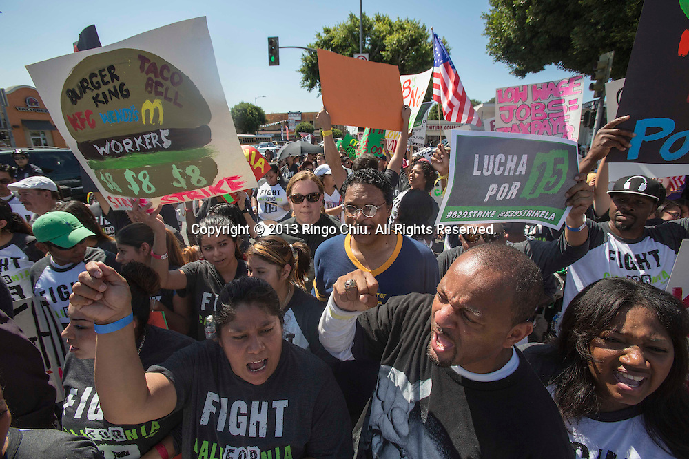 Fast food workers and their supporters picket outside McDonald's restaurant in Los Angeles, Califonia, on August 29, 2013. Fast food workers walked off their jobs as part of a nationwide strike demanding higher wages and the right to form a union. (Photo by Ringo Chiu/PHOTOFORMULA.com)