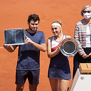 PARIS, FRANCE June 10. Elena Vesnina and Aslan Karatsev of Russia with their runners up trophies after their loss against Desirae Krawczyk of the United States and Joe Salisbury of Great Britain in the mixed doubles final on Court Philippe-Chatrier during the 2021 French Open Tennis Tournament at Roland Garros on June 10th 2021 in Paris, France. (Photo by Tim Clayton/Corbis via Getty Images)
