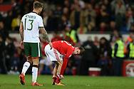A dejected Ben Woodburn of Wales looks on at the end of the match. Wales v Rep of Ireland , FIFA World Cup qualifier , European group D match at the Cardiff city Stadium in Cardiff , South Wales on Monday 9th October 2017. pic by Andrew Orchard, Andrew Orchard sports photography