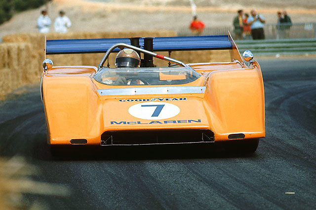 Peter Revson, the first American to win the Can-Am championship, rounds Laguna Seca's hairpin in his 1971 McLaren M8F. Days later, Revvie gave Pete the ride of his life in this incredible machine at Riverside.