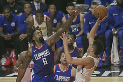 October 21, 2017 - Los Angeles, California, U.S - DeAndre Jordan #6 of the Los Angeles Clippers and Devin Booker #1 of the Phoenix Suns during their regular season game on Saturday October 21, 2017 at the Staples Center in Los Angeles, California. Clippers defeat Suns, 130-88. (Credit Image: © Prensa Internacional via ZUMA Wire)