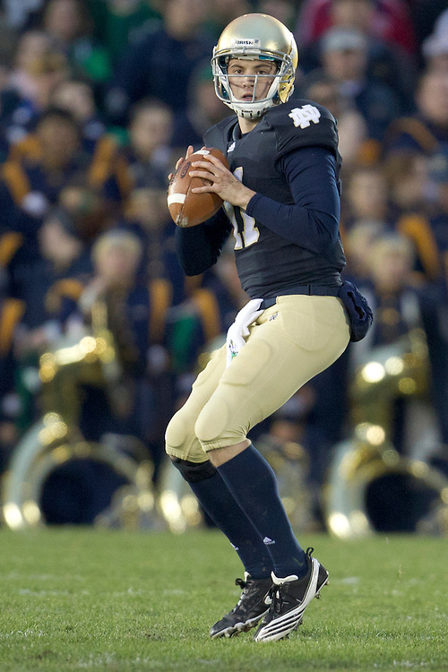 Notre Dame quarterback Tommy Rees (#11) sets to deliver pass during first quarter of NCAA football game between Notre Dame and Boston College.  The Notre Dame Fighting Irish defeated the Boston College Eagles 16-14 in game at Notre Dame Stadium in South Bend, Indiana.