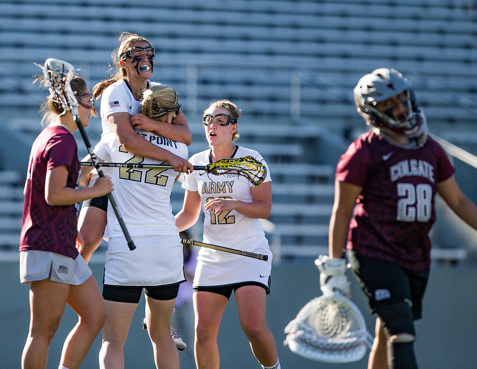 Brittany Rinaldi (27) of Army West Point, Erin Jollota (22) of Army West Point, and Amy Johnston (12) of Army West Point during a NCAA Women's Lacrosse game between Army West Point and Colgate at Michie Stadium on April 20, 2016 in West Point, New York.
