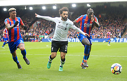 Liverpool's Mohamed Salah in action against Crystal Palace's Patrick van Aanholt (left) and Mamadou Sakho battle for the ball during the Premier League match at Selhurst Park, London.