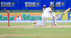 August 5, 2017 - Colombo, Sri Lanka - Sri Lankan cricketer Niroshan Dickwella is bowled out by  Indian fast bowler ..Mohammed Shami (unseen) during the 3rd Day's play in the 2nd Test match between Sri Lanka and India at the SSC international cricket stadium at the capital city of Colombo, Sri Lanka on Saturday 5th August 2017. (Credit Image: © Tharaka Basnayaka/NurPhoto via ZUMA Press)