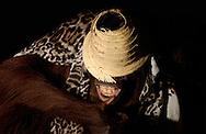 Deutschland, DEU, Krefeld, 2004: Projekt ueber die biologischen Wurzeln der Mode. Die Shootings hierfuer wurden mit Grossen Menschenaffen, die dem Menschen am naechsten sind, im Krefelder Zoo gemacht. Die Tiere waren weder zahm noch trainiert. Die Kleidungsstuecke wurden in die Gehege geworfen und was immer die Tiere damit anstellten, taten sie aus sich selbst heraus. Ein Eingreifen oder gar eine Regie war unmoeglich. Da das Verhalten der Affen im Mittelpunkt stand, wurden die Hintergruende von den Originalfotografien entfernt. Orang-Utan-Weibchen Sita mit einem Rock von Ulla Popken un den Ueberresten eines Sombreros, gesehen bei Aus aller Welt in Muenchen. | Germany, DEU, Krefeld, 2004: Project to look at the basics and roots of fashion. The shootings took place in the Zoo Krefeld with three species of Great Apes who are the nearest to us. The animals were neither tamed nor trained. Whatever the animals did, they did on their own. Any intervention or directing was impossible. To set the focus on the behaviour of the animals itself we removed the background from the original photographs. Orang Utan (Pongo pygmaeus) female Sita with skirt from Ulla Popken and remain of sombrero seen at Aus aller Welt in Munich. |