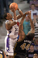 Kansas State forward Cartier Martin (L) puts up a shot over Missouri's Kalen Grimes (R) during K-State's 79-64 win over the Tigers at Bramlage Coliseum in Manhattan, Kansas, January 21, 2006.
