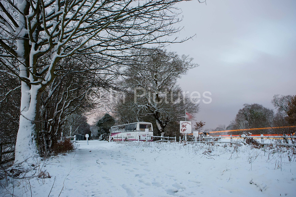 A wintry scene at Blackwell Bus Cafe along the A12 on the 18th December 2009 in Blackwell in the United Kingdom. The Blackwell Bus Cafe is a converted bus serving commuters and traffic on the busy A12, outside of Ipswich.