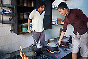 India - Delhi - Two young cooks make a curry at Babu Shahi Bawarchi, New Delhi, India<br /> Babu Shahi Bawarchi is a famous but modest takeaway housed in the grounds of a shrine is famous for its biryani and whose owners ancestors served as chief cooks under the Moghul Emperor, Shah Jahan