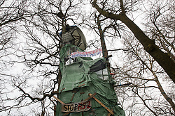Steeple Claydon, UK. 23 February, 2021. A tower bearing anti-HS2 banners is pictured during an operation by National Eviction Team bailiffs acting on behalf of HS2 Ltd to evict activists opposed to the HS2 high-speed rail link from ancient woodland known as Poors Piece. The activists created the Poors Piece Conservation Project there in spring 2020 after having been invited to stay on the land by its owner, farmer Clive Higgins. Already, local village communities have been hugely impacted by HS2, with 550 acres of land seized including a large section of a nature reserve.