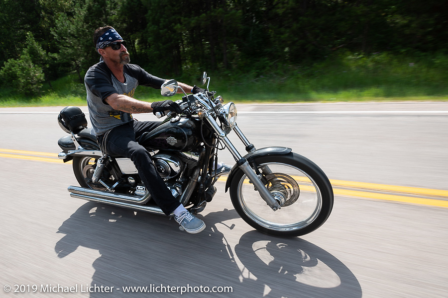 Jeff Marquardt riding his 2005 Harley-Davidson Dyna Wide Glide on the Cycle Source ride down Vanocker Canyon back from Nemo to the Iron Horst Saloon during the Sturgis Black Hills Motorcycle Rally. SD, USA. Wednesday, August 7, 2019. Photography ©2019 Michael Lichter.