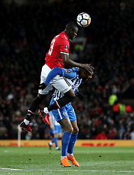 Manchester United's Eric Bailly (top) and Brighton & Hove Albion's Jurgen Locadia battle for the ball during the Emirates FA Cup, quarter final match at Old Trafford, Manchester.