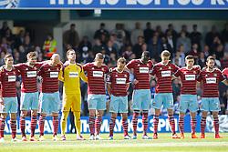West Ham players observe a minutes silence - Photo mandatory by-line: Mitchell Gunn/JMP - Mobile: 07966 386802 - 25/04/2015 - SPORT - Football - London - Loftus Road<br />  - QPR v West Ham United - Barclays Premier League