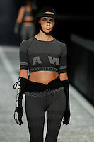 Natasha Poly walks the runway wearing Alexander Wang for H&M in New York on October 16th, 2014