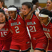 From left Biola guard Stephanie Lee (15), guard Jelissa Puckett (2), forward Madi Chang (21) and guard Tatum Brimley (10) smile after their win during the PacWest basketball championships in the Felix Event Center at Azusa Pacific University Thursday, Mar. 5, 2020, in Azusa. (Mandatory Credit: Samantha Linczyc-Sports Shooter Academy)
