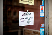 """A Prague restaurant closed because of the Covid-19 situation and gouvernmental restrictions. The paper reads """"Closed until the government allows it to open""""."""
