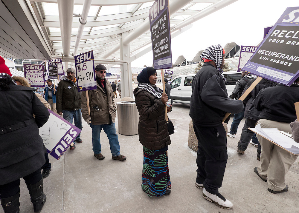 Nimo Mohamed, center, walks with Twin Cities janitors represented by Service Employees International Union during a picket for a wage increase at Minneapolis-St. Paul International Airport's Terminal 1 February 17, 2016.  The union is asking for $15 for both full and part-time workers.