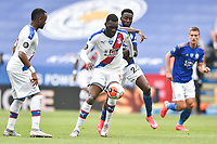 LEICESTER, ENGLAND - JULY 04: Christian Benteke of Crystal Palace tries to control the ball ahead of Wilfred Ndidi of Leicester City during the Premier League match between Leicester City and Crystal Palace at The King Power Stadium on July 4, 2020 in Leicester, United Kingdom. Football Stadiums around Europe remain empty due to the Coronavirus Pandemic as Government social distancing laws prohibit fans inside venues resulting in all fixtures being played behind closed doors. (Photo by MB Media)