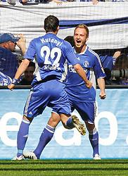 03.04.2010, Veltins Arena, Gelsenkirchen, GER, 1.FBL, Schalke 04 vs Borussia Moenchengladbach, im Bild:  gemeinsam jubeln 1:0 Torschuetze Ivan Rakitic (Schalke - CRO/SUI #10) und Kevin Kuranyi (Schalke - GER/BRA #22), EXPA Pictures © 2010, PhotoCredit: EXPA/ nph/  Scholz  *** Local Caption *** / SPORTIDA PHOTO AGENCY
