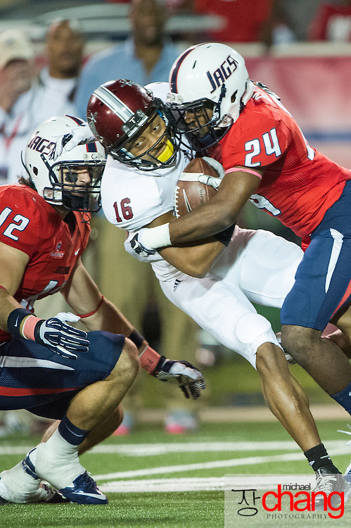 MOBILE, AL - OCTOBER 24: Wide receiver Chandler Worthy #16 of the Troy Trojans gets hit by wide receiver T.J. Glover #24 of the South Alabama Jaguars on October 24, 2014 at Ladd-Peebles Stadium in Mobile, Alabama.  The South Alabama Jaguars defeated the Troy Trojans 27-13. (Photo by Michael Chang/Getty Images) *** Local Caption *** Chandler Worthy; T.J. Glover
