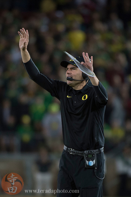 November 14, 2015; Stanford, CA, USA; Oregon Ducks head coach Mark Helfrich instructs during the fourth quarter against the Stanford Cardinal at Stanford Stadium. The Ducks defeated the Cardinal 38-36.