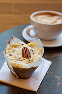Baked and Wired, a bakery and coffee and tea house in Georgetown, Washington, DC, offers up home made desserts and gourmet coffee..Pictured here is the German Chocolate Cupcake and a cappuccino.