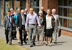© Licensed to London News Pictures. 25/07/2013. Bulford, Wiltshire, UK.  Sergeant Danny Nightingale (light blue shirt) walks free from court with a suspended sentence.  Pictured with his wife Sally at the Military Court Centre in Bulford Camp.  Sergeant Nightingale is a former SAS sniper who has been convicted on a retrial for illegal possession of a Glock handgun and ammunition, which was found in his possessions in the UK.  His previous case was quashed on appeal.  25 July 2013.<br /> Photo credit : Simon Chapman/LNP