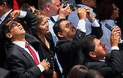 VIP guests turn their cameras to the sky hoping to see a sign from the heavens. Catholic priests from around the world  arrived at Plaza Salvador del Mundo ( Savior of the World) as El Salvador celebrated a ceremony and mass announcing the beatification of Archbishop Oscar Romero. The Archbishop was slain at the alter of his Church of the Divine Providence by a right wing gunman in 1980. Oscar Arnulfo Romero y Galdamez became the fourth Archbishop of San Salvador, succeeding Luis Chavez, and spoke out against poverty, social injustice, assassinations and torture. Romero was assassinated while offering Mass on March 24, 1980.