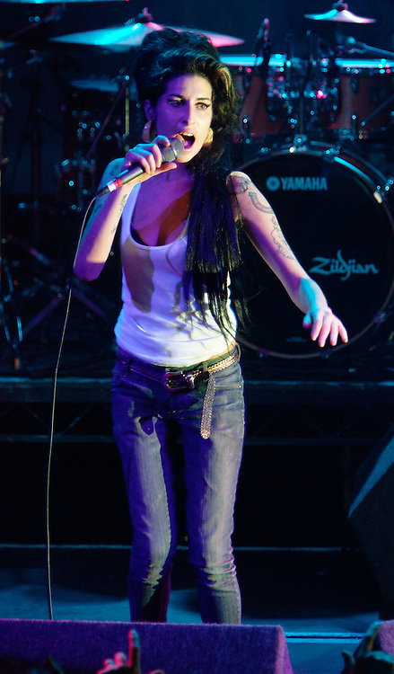 Singer Amy Winehouse, DOB=14/09/1983, performing for her gay fans at the G-A-Y Club. G-A-Y is London's biggest gay club and is held at the London Astoria nightclub, Soho, London, UK. Amy spent much of the show rubbing her itchy nose. She also seemed to have signs of old scars all down one arm...Picture Data:.Photographer: Edward Hirst.Copyright: ©2007 Licensed to Equinox News Pictures +448700 780000.Contact: Equinox Features.Date Taken: 20070415.Time Taken: 014840+0000.www.newspics.com