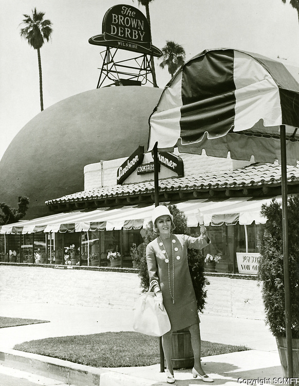 1966 Gloria Swanson outside The Brown Derby Restaurant on Wilshire Blvd.