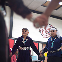 Katie Pablo, left, and Logan Henio from Della James Navajo language class at Washington Elementary performs a dance at the start of the Chile Cook off and cultural night at Washington in Gallup Thursday. The event was hosted by both Washington and Juan de Oñate Elementary Schools as a celebration of them combining into Del Norte Elementary.