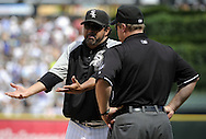 CHICAGO - JUNE 27:  Manager Ozzie Guillen #13 of the Chicago White Sox argues a call with first base umpire Bruce Dreckman #1 during the game against the Chicago Cubs on June 27, 2010 at U.S. Cellular Field in Chicago, Illinois.  The Cubs defeated the White Sox 8-6.  (Photo by Ron Vesely)