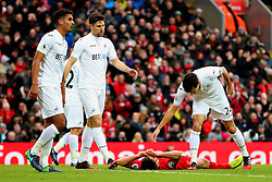 Jack Cork of Swansea City consoles a dejected Adam Lallana of Liverpool - Mandatory by-line: Matt McNulty/JMP - 21/01/2017 - FOOTBALL - Anfield - Liverpool, England - Liverpool v Swansea City - Premier League