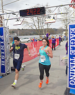 Kauneonga Lake, New York - Nick Santini (270) of Garden City and Jackie Terpstra (423) of Hurleyville cross the finish line in the Allyson Whitney 5K Walk/Run on May 10, 2014. The Allyson Whitney Foundation is a public charity organization that empowers and fights for the interests of young adults with rare cancers.